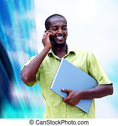 Young happy black man or student with laptop on the business...