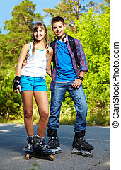 Couple of roller skaters - Couple of happy teens on roller...