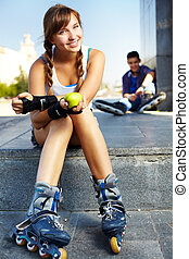 Pretty roller skater - Cute teenage girl looking at camera...