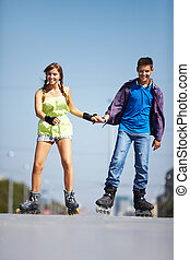 Couple of roller skaters - Couple of happy teens rolling on...
