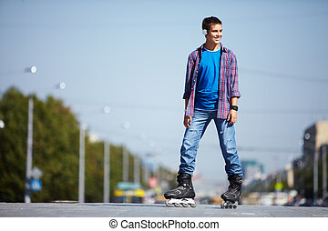 Lad on roller skates - Image of happy teenager on roller...
