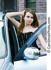 Happy young woman with a car key