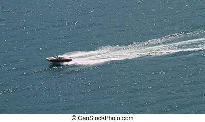 Motor boat on summer lake