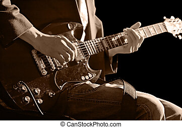 guitarist - musician with guitar isolated on black...
