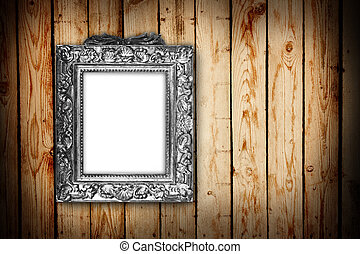 silver frame on a wood background