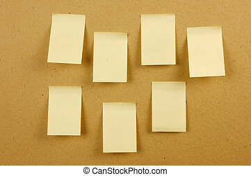sheets of paper stuck to the wall brown