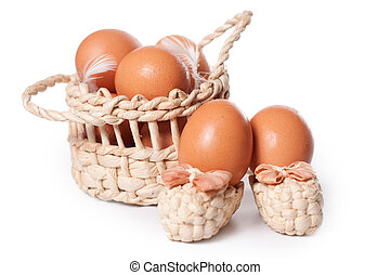 Eggs in the basket on a white background