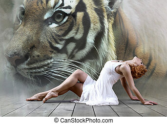 Woman dancer seating posing on wild annimals background