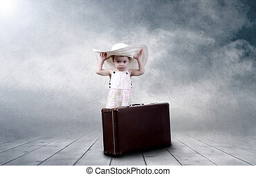 Little girl sitting outdoors on the vintage baggage