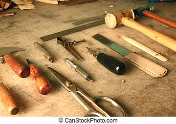 Set of leather working tools on a workbench