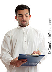 Ethnic business man writing - A traditional dressed arab or...