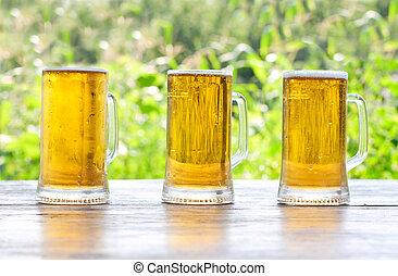 three mug of beer