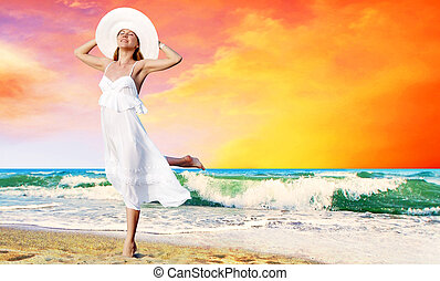 Young beautiful women in the white with pareo on the sunny...