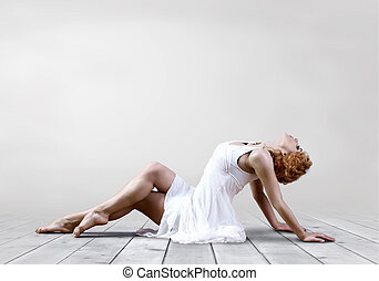 Woman dancer seating posing on background - Woman dancer...
