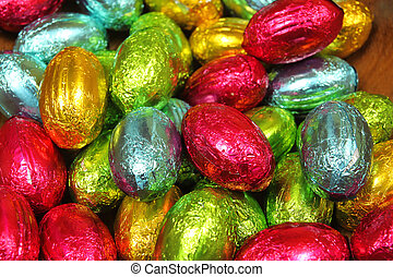 Multi colored eggs - Stack of chocolate eggs in multi...