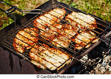 Barbeque Steaks - fresh juicy stakes grilling on the...