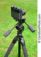 The camera and tripod - The camera is mounted on a tripod,...