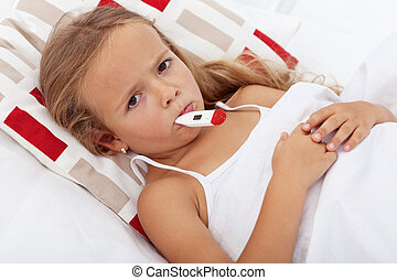 Sick kid in bed holding thermometer between lips