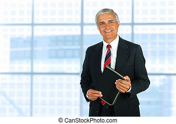 Middle Age Businessman - Smiling middle aged businessman in...