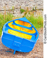 Rowing boat - Brightly colored rowing boat moored on a...