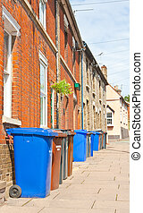 Bin day - Row of plastic wheely bins outside terraced houses...