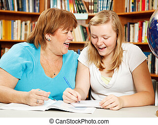 Studying with Mom - Teen girl in the library studying with...