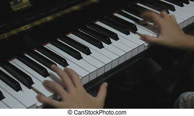 Hands playing piano - Hands of a little Asian kid learning...
