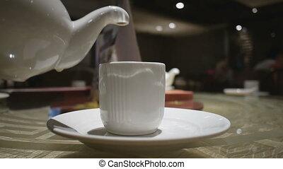 Serving tea - Serving the tea in the restaurant