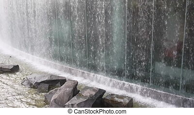 Urban waterfall near the East Rail Station of Guangzhou,...