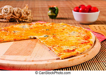 italian sliced pizza on table