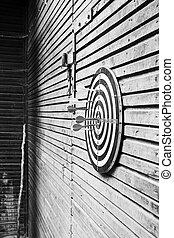 Dartboard on wood wall