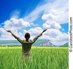 Girl in meadow.  - Girl in green meadow. Emotion scene.