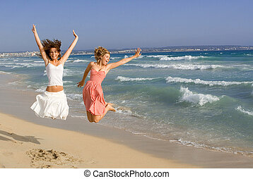happy young women on beach summer vacation or spring break