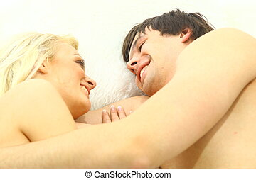 Lovely young couple having fun in the bedroom