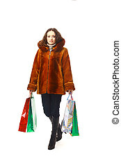 girl in winter clothes with shopping bags, isolated on white