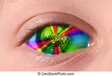 eye - A human eye with 2 euro coin in colored light