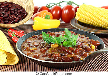 Chili con carne - a pan with chilli con carne and parsley
