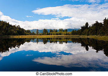Lake Matheso - Dramtic reflections on Lake Matheson near Fox...