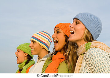group of carolers or carol singers singing or sports...