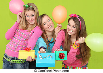happy kids at birthday party giving wrapped gifts or...
