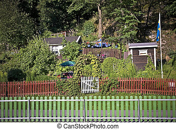 Allotment with red wooden fence