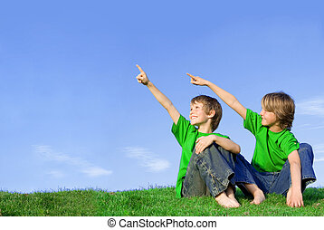 kids or children pointing at copy space outdoors in summer