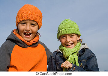 happy smiling, winter kids, in hats and scarves