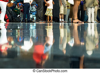 Airport crowd - Legs of people in airport departure hall,...