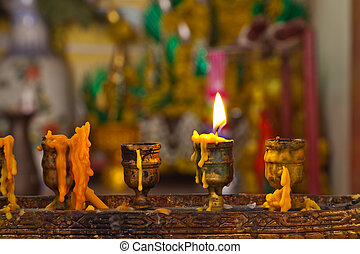 Candles lighting in temple