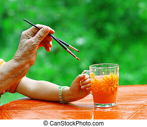Hands of young and old artists
