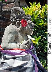 Demon statue in temple garden
