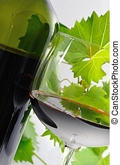 Red wine - Opened bottle of red wine with a glass of red...