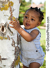 Cute african american baby boy at park