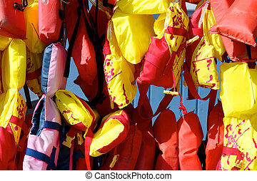 colorful life vests for boaters - Numerous multicolored...